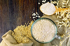 Flour and bran oat on board Royalty Free Stock Photos