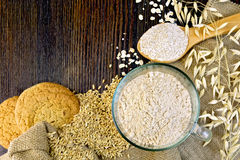 Flour and bran oat with cookies on board Stock Image