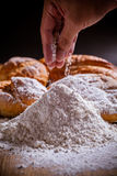 Flour and bread. Man hand cooking flour and bread royalty free stock photo