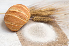 Flour, bread and wheat Stock Images