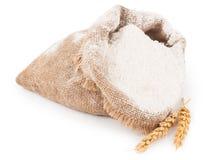 Flour in burlap bag with wheat ears Stock Photos