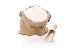 Flour in burlap bag. Stock Photo