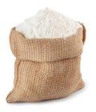 Flour in burlap sack isolated on white Stock Photos