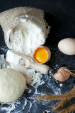 Flour  in burlap with wooden spoon and eggs. Stock Photo
