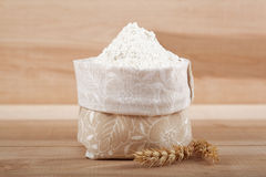 Flour in a canvas bag and ear of wheat. Stock Photo