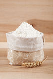 Flour in a canvas bag and ear of wheat. Royalty Free Stock Image