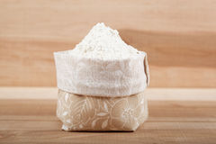 Flour in a canvas bag and ear of wheat on the wooden. Royalty Free Stock Image
