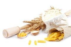 Flour in a canvas bag and ear. Royalty Free Stock Photos