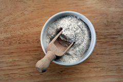 Flour in a ceramic bowl royalty free stock images
