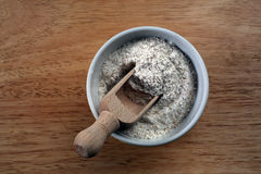 Flour in a ceramic bowl royalty free stock photography
