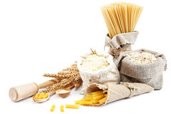 Flour, cereals, pasta in a canvas bag and ear. Flour, cereals, pasta in a canvas bag and ear on white background Stock Photo