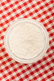 Flour on checkered tablecloth Royalty Free Stock Photography