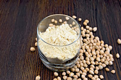 Flour chickpeas in glassful on board Stock Photo