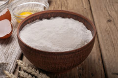 Flour in a clay bowl with ears of wheat Stock Photos