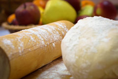 Flour close-up, sprinkled on the dough and cooking utensils Royalty Free Stock Images