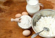 Flour, cottage cheese, milk. eggs Stock Photography