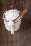 Flour in cup Stock Photos