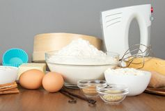 Flour, dairy products, eggs, spices and mixer Stock Photos
