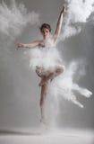 Flour dance. Studio portrait of woman dancing with flour Stock Photos