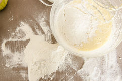 Flour and dough in bowl Royalty Free Stock Photography