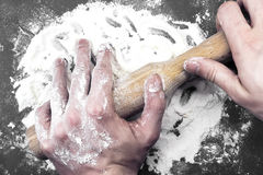 Flour dough and rolling pin. Flour in capacity with dough and rolling pin Stock Images
