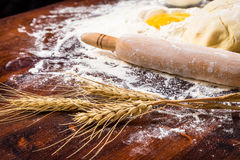 Flour, ear and egg on table Stock Image