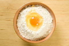 Flour and egg in bowl Royalty Free Stock Photos