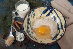 Flour and egg in a bowl, milk and spices - for cooking pancakes. stock photo