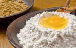 Flour with Egg Well. A bowl of sifted flour with egg well stock images
