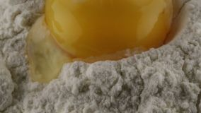 Flour and egg yolk. Bio stock footage