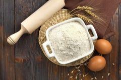 Flour and eggs Stock Photos