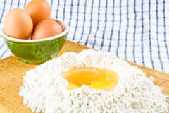 Flour and eggs Royalty Free Stock Photos