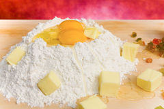 Flour, Eggs And Butter - Closeup. Food & Drinks - Ingredients for Torta Coi Bischeri. The torta coi bischeri, a typical Pisan dessert, is simply a chocolate rice Royalty Free Stock Photos