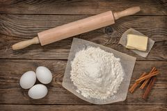 Flour, eggs, butter and cooking equipment. Cooking Royalty Free Stock Photo