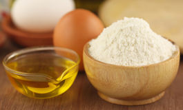 Flour with eggs and cooking oil Royalty Free Stock Images
