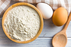 Flour and eggs on kitchen table Stock Image