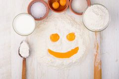 Flour, eggs, milk, salt, baking ingredients Stock Photos