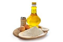 Flour, eggs, oil Stock Photos