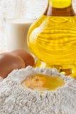 Flour, eggs, oil-ingredients Royalty Free Stock Photos
