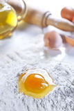 Flour Eggs Olive Oil and Rolling Pin Stock Photo