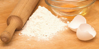 Flour and eggs Stock Photos