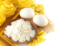 Flour and eggs for preparation of a spaghetti Royalty Free Stock Images