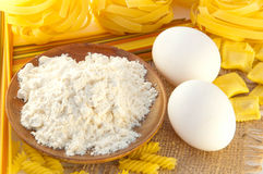 Flour and eggs for preparation of a spaghetti Stock Image