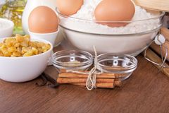 Flour, eggs, raisin, sesame, vanilla and cinnamon Stock Photo
