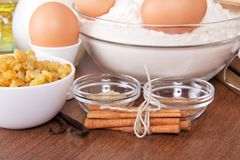 Flour and eggs, raisin, sesame, vanilla, cinnamon Royalty Free Stock Photos