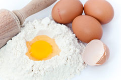 Flour, eggs and rolling pin Stock Image