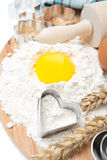 Flour, eggs, rolling pin and baking forms, top view Royalty Free Stock Image
