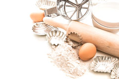 Flour, eggs, rolling pin and cookie cutters. Baking ingredients Royalty Free Stock Images