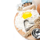 Flour, eggs, rolling pin, measuring spoons and baking forms Royalty Free Stock Photos