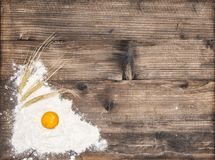 Flour eggs rustic wooden background. Flour and eggs on rustic wooden background Royalty Free Stock Photos